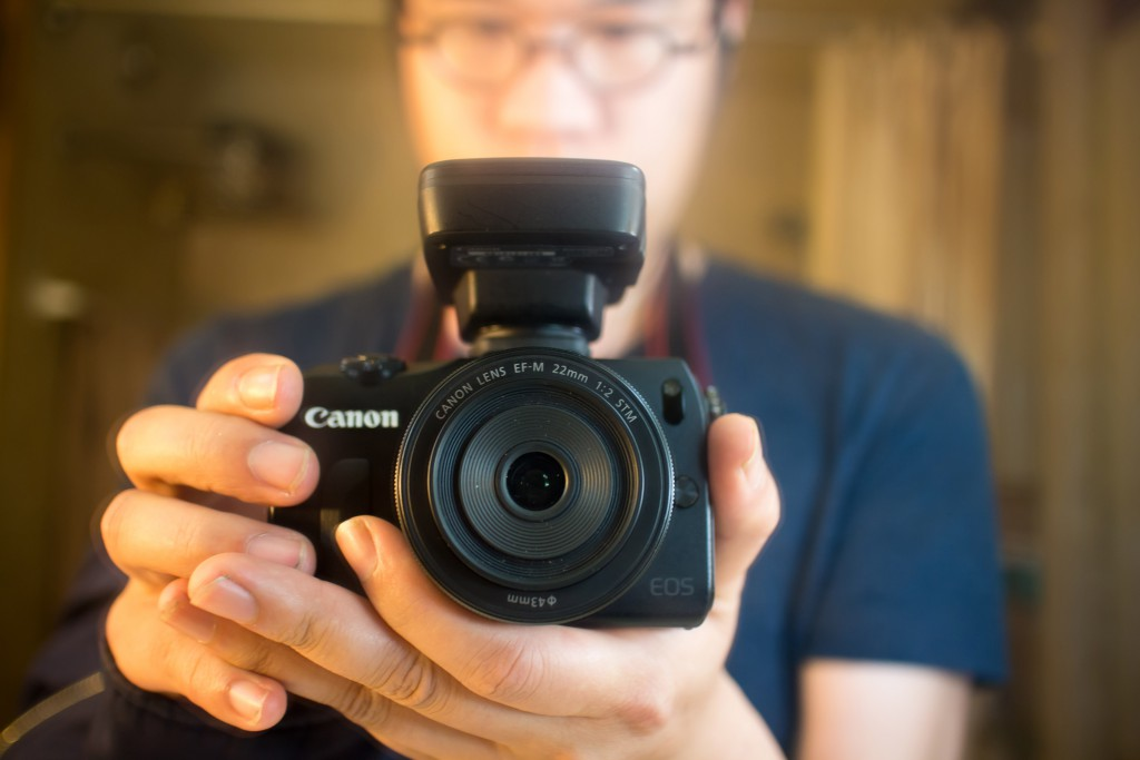 """I have been using the Canon EOS M for a while now and I must say that I am very happy with it. Exactly how small is it? It is smaller than my Canon G12. The Canon GP-E2 is attached here and you can see just how tiny the camera is. While I usually attach my L lenses with the camera, the EF-M 22mm f/2 STM (pictured) actually performs quite nicely. As a prime lens with a maximum aperture of f/2 while being incredibly thin, I have been able to do quite a bit of night photography on the street without catching the attention of people. And this is key. In the past most photographers consider the Leica M to be the holy grail of street photography because it is small and it has amazing quality. Well, I think now this is my camera of choice for that same purpose. And as you can see, the bokeh is not half bad either. The image sensor has the same size and pixel count as the 7D which I also own—seriously. And of course it can take any lenses and accessories which the 7D can take also. The only thing which is it not as good as is the focusing speed—but otherwise it is a great little camera. Highly recommended! # SML Data + Date: 2013-03-31T18:53:54.00+0800 + Dimensions: 5184 x 3456 + Exposure: 1/30 sec at f/2.0 + Focal Length: 22 mm + ISO: 400 + Camera: Canon EOS M + Lens: Canon EF-M 22mm f/2 STM + GPS: 22°25'9"""" N 114°13'25"""" E + Location: SML Universe HKG + Serial: SML.20130331.EOSM.03646 + Workflow: Lightroom 4 + Series: 廁所的我 Bathroom SML Me, SML Opinions """"SML + Canon EOS M + Canon EF-M 22mm f/2 STM"""" / SML Universe 廁所的我 Bathroom SML Me / SML.20130331.EOSM.03646 / #廁所的我 #BathroomSMLMe #SMLMe #CCBY #SMLPhotography #SMLUniverse #SMLProjects #SMLOpinions #SMLLove #SMLRec / #中國 #中国 #China #香港 #HongKong #攝影 #摄影 #photography #廁所 #Bathroom #LGBT #同志 #Gay #Men #people #me #gaymen #instagay #gaysian #selfie #cameras #Canon #opinions #recommended"""