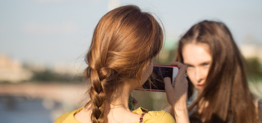 Two russian girls taking photos of each other